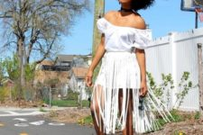 With white off the shoulder mini dress and black flat shoes