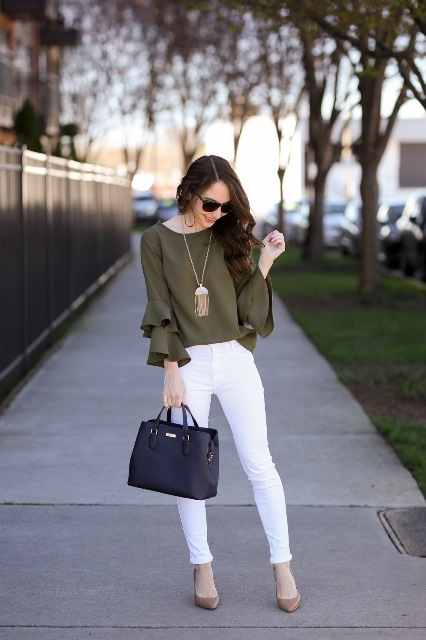 With white pants, beige pumps and leather bag