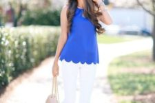 With white pants, platform shoes and beige bag