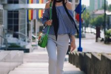 With white pants, platform shoes, black scarf and green bag