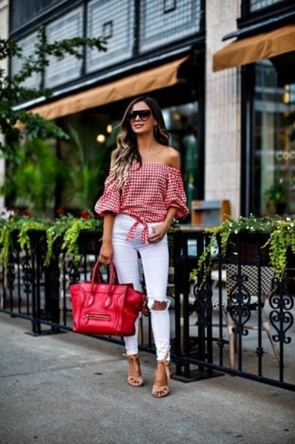 With white pants, red big bag and beige sandals