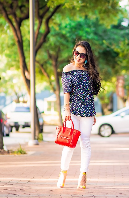 With white pants, yellow high heels and red mini bag