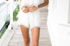 With white pom pom top and brown sandals