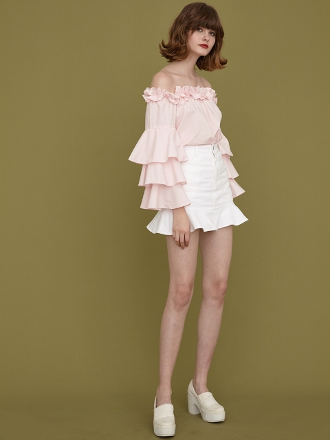 Ruffle sleeve shirt with white ruffled skirt and platform shoes