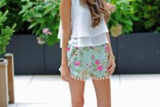 With white ruffled top and brown shoes