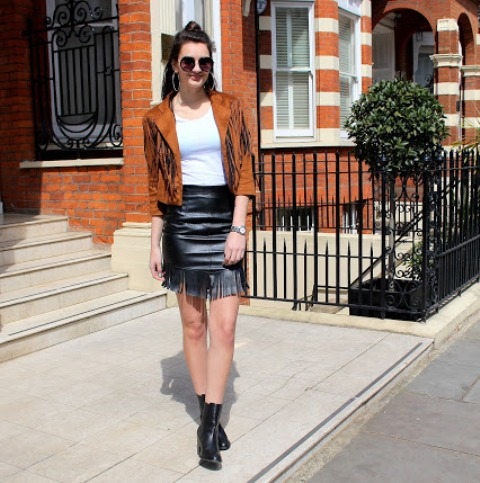 With white shirt, fringe jacket and ankle boots