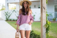 With white shorts, wide brim hat, straw bag and flat sandals