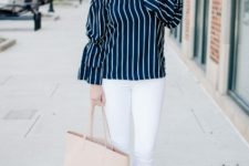 With white skinny pants, gray suede shoes and pale pink tote