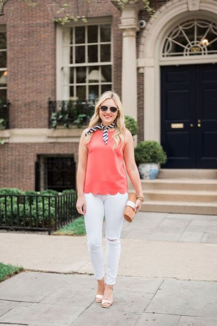 With white skinny pants, high heels, clutch and printed scarf
