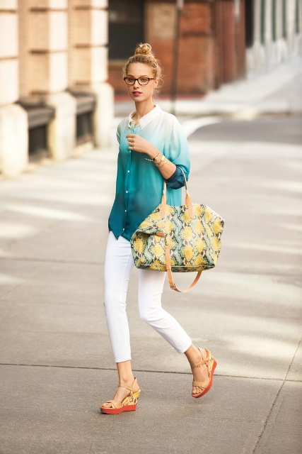 With white skinny pants, sandals and printed tote