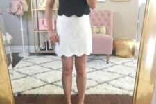 With white skirt and pink pumps