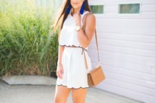 With white skirt, high heels and brown bag