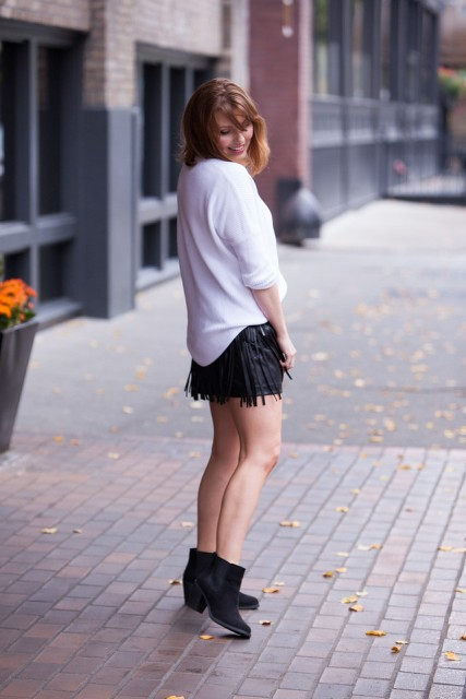 With white sweatshirt and suede ankle boots