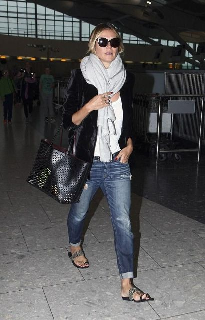 With white t shirt, white scarf, black jacket, tote and jeans