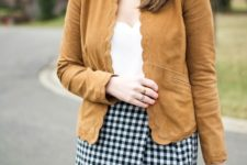 With white top, checked skirt and printed bag