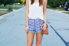 With white top, flat sandals and brown mini bag