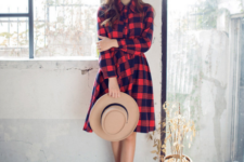 With wide brim hat and fringe boots
