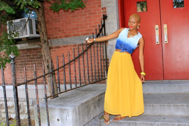 With yellow maxi skirt and flat sandals