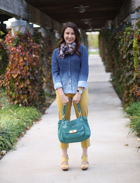 With yellow pants, yellow platform sandals, printed scarf and teal bag