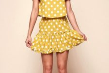 With yellow polka dot skirt and lace up heels