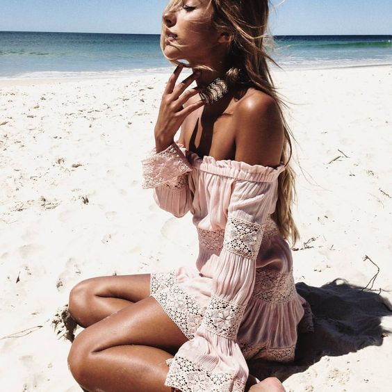 a blush off the shoulder mini dress with white lace detailing for a beach vacation