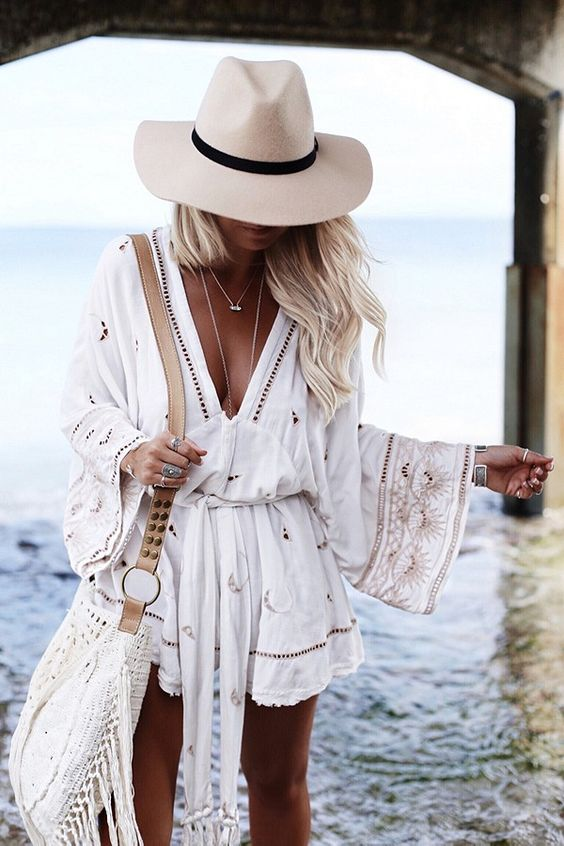 70d8c2b8e4a a boho white beach romper with lace detailing and embroidery plus a  plunging neckline