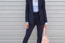 02 a navy suit with cropped pants, a blue shirt, nude heels and a blush bag