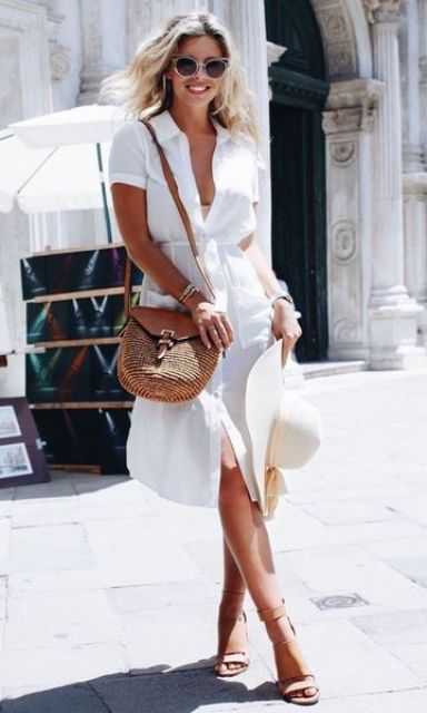 a white shirtdress with pockets, tan sandals and a hat for a relaxed feel