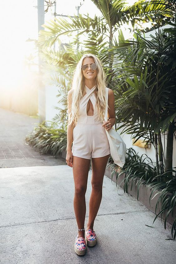 a blush beach romper with a criss cross front is a wow idea