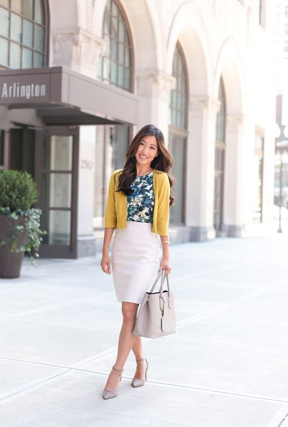 a creamy skirt, a tropical leaaf top, a mustard bolero, nude shoes and a grey bag