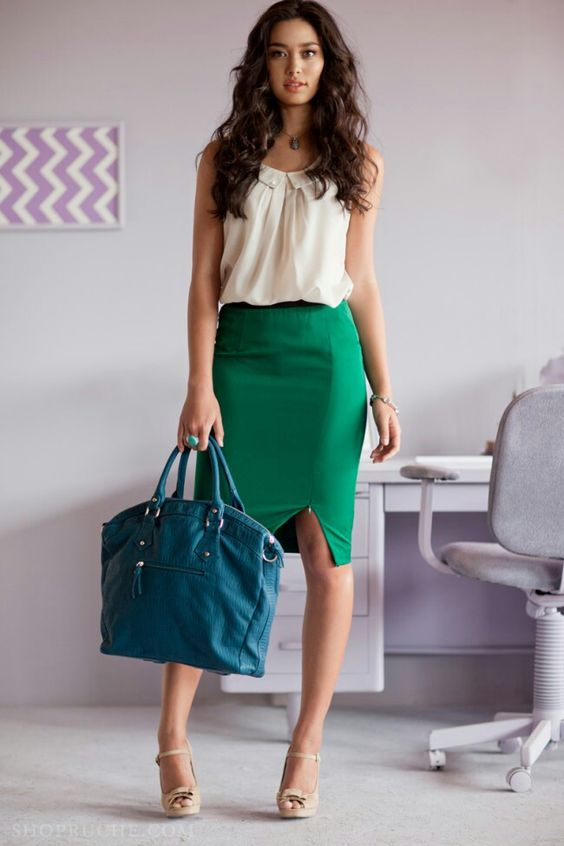 a bold green pencil skirt, a neutral blouse, nude shoes and a teal bag for a colorful statement