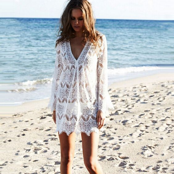 a white lace beach tunic with bell sleeves and a V-neckline is comfy and ideal for a boho girl