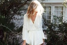 04 a white lacey beach romper with bell sleeves is ideal for a boho chic look