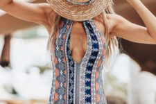 05 a colorful printed one piece swimsuit with a halter plunging neckline for a boho look