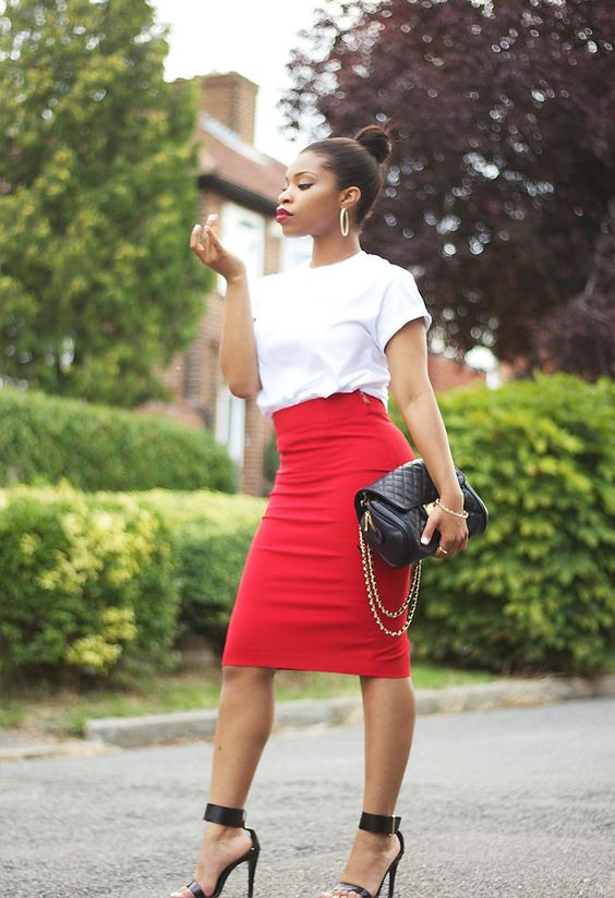 a red pencil skirt, a white tee, black ankle strap shoes and a clutch