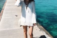 05 a white tunic with bell sleeves and lacing up is comfy to wear