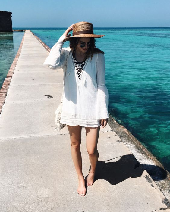 a white tunic with bell sleeves and lacing up is comfy to wear