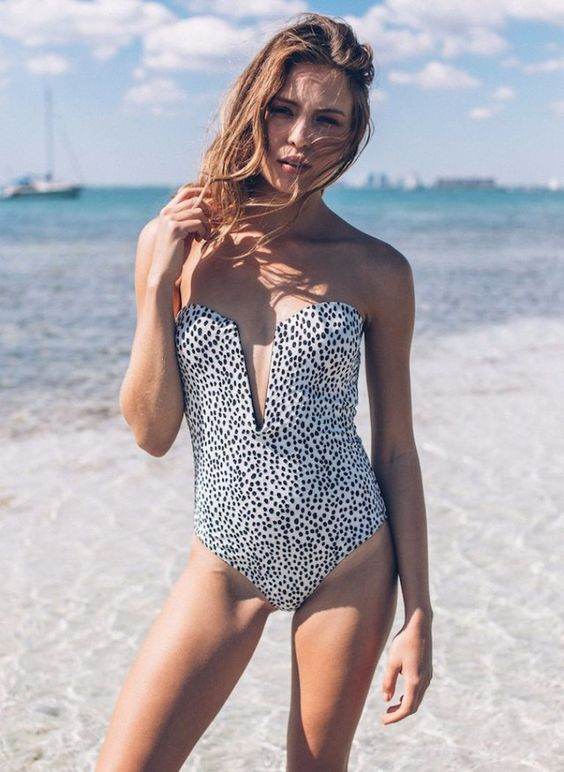 a dolmatin print one piece strapless swimsuit with a plunging neckline