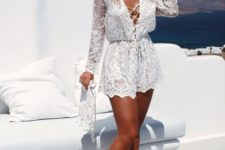 06 a fantastic white lace romper with lacing up and lon sleeves for a beach party or honeymoon
