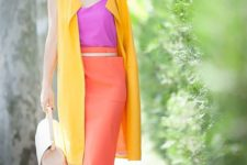 06 a hot pink top and shoes, an orange midi skirt, a long yellow vest and a creamy bag