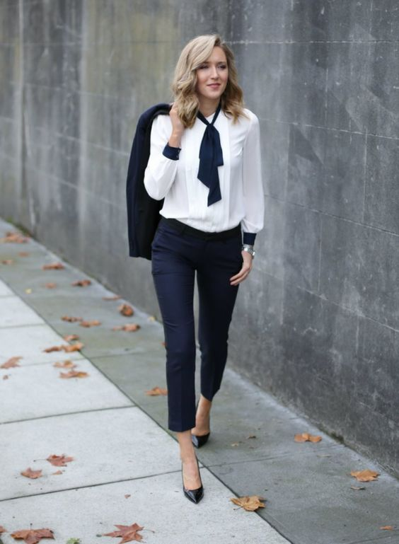 a navy suit with cropped pants, a white shirt, a navy bow, black heels for an office look