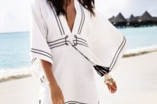 07 a bold beach tunic with a plunging neckline, bell sleeves and black detailing plus tassels