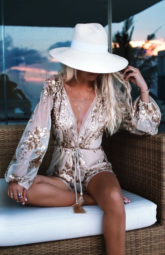 a luxurious blush beach romper with sequin detailing and a plunging neckline is ideal for beach parties