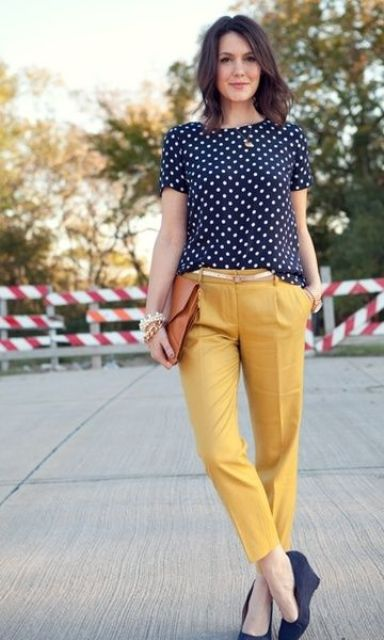 d4659171d013 casual summer work outfit with a navy and white polka dot top, yellow pants  and