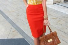 07 a reddish orange skirt, a printed yellow blouse, yellow shoes and a brown bag