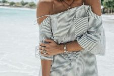 07 a striped black and white mini dress with a cold shoulder looks very beach-like