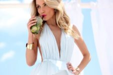 07 a white plunging neckline peplum one piece swimsuit is a super feminine and cool idea