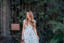 08 a blue maxi dress with a pink floral print, cap sleeves, tan shoes and a straw bag