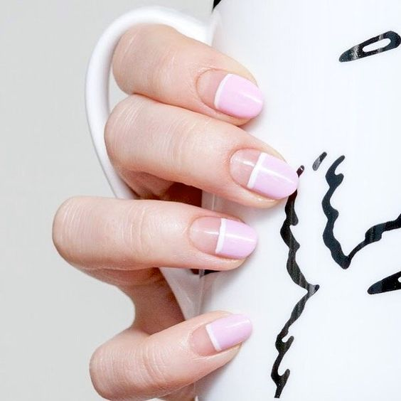 a colorful minimalist manicure with a negative space, white and pink touches