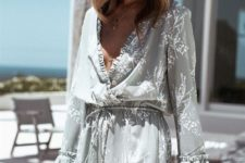 08 a grey romper with white floral prints, ruffles, bell sleeves for a free-spirited look
